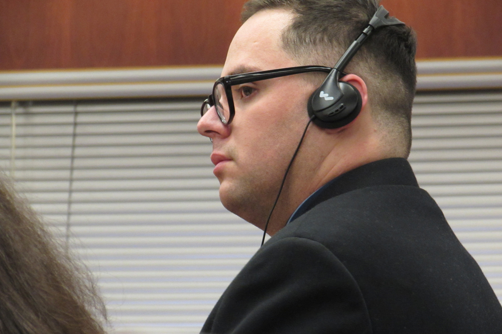 Defendant Eduardo Robles, wearing headphones because he uses a court interpreter, listens during his murder trail Friday in Santa Barbara County Superior Court.