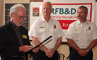 Tim Owens, executive director of Recording for the Blind & Dyslexic, thanked local fire agencies for their service, especially during last year's Gap and Tea fires. Among fire officials on hand to help with the Record-A-Thon were Santa Barbara County fire Chief Tom Franklin, right, and Santa Barbara fire Chief Ron Prince.