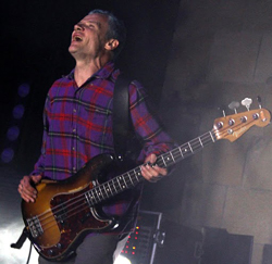 Red Hot Chili Peppers bassist Flea brought his interminable energy to Saturday night's concert