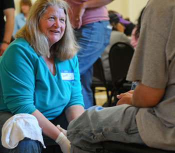 Sixty-five volunteers gathered Thursday to wash the feet of the homeless.