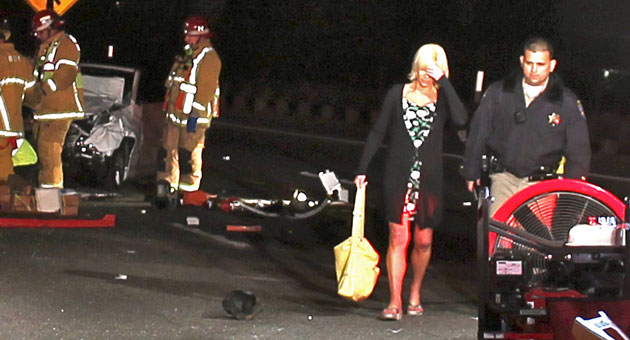 Kimberly Ann Kreis, 52, of Santa Barbara, is taken into custody on DUI charges early Monday after being involved in a Highway 101 crash that killed three people and critically injured another. (Urban Hikers photo)