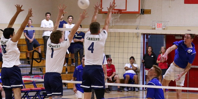 Jake Sofro of San Marcos hits against the Dos Pueblos three-man block of, from left, Curren Malhotra, Elliot Brainerd and Eli Wopat.