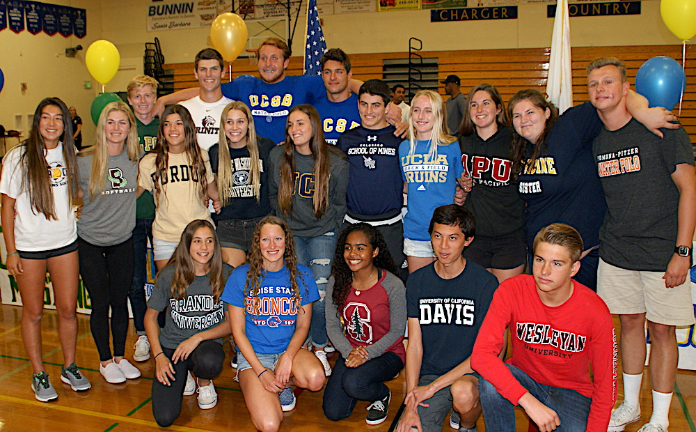 The Dos Pueblos student athletes honored at a letter-of-intent signing ceremony include, back row, from left: Hunter Clark (Cal Poly, cross country), Colter Nisbet (Trinity, baseball), Taylor Gustason (UCSB, water polo), Teodor Velikov (UCSB, swimming); Middle row: Raquel Uyesaka (UC Santa Cruz, softball), Anya Schmitz (Brown, softball), Siena Wagner (Purdue, softball), Grace Heck (George Washington, water polo), Toni Shackelford (UC Irvine, water polo), Ryan Fidel (Colorado School of Mines, wrestling), Christina Rice (UCLA, cross country), Britni Tisdale (Azusa Pacific, water polo), Christina Shackelford, the older sister of Toni, Dylan Elliott (Pomona-Pitzer, water polo). Bottom row: Camila Casanueva (Brandeis, basketball), Cassandra Barkhorn (Boise State, swimming), Kiara Pickett (Stanford, soccer), Spencer Kemmerer (UC Davis, track & field), Eric Lindheim-Marx (Wesleyan, swimming).