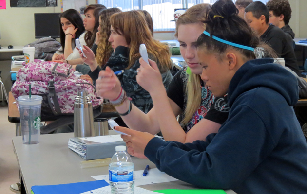 <p>Chemistry students at Orcutt Academy High School answer a true-or-false question using electronic &#8220;clickers,&#8221; which post real-time results for teachers. The SOAAR (Supporting Orcutt Academy&#8217;s Academic Resources) program raised $2,000 to purchase the devices.</p>