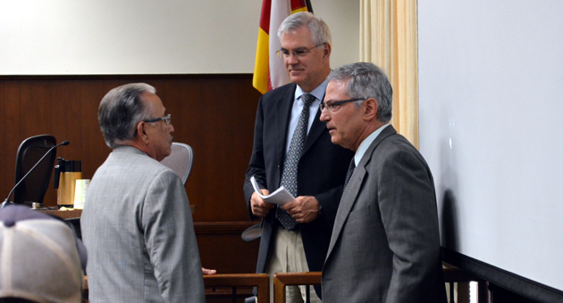 Santa Barbara's three dimensions — from left, Police Chief Cam Sanchez, City Administrator Jim Armstrong and City Attorney Ariel Calonne — confer during a council hearing on the city's gang injunction case. (Giana Magnoli / Noozhawk photo)