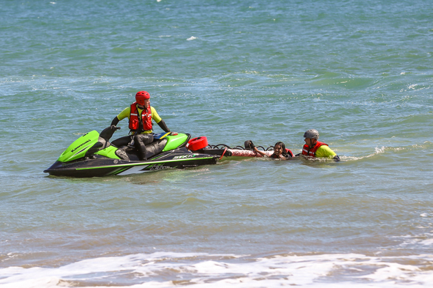 Santa Barbara County Fire Department water rescue team members help kayakers back to Goleta beach after winds blow the craft a half-mile offshore Friday afternoon.