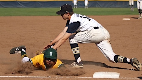 DP third baseman Kevin Barker tags out Santa Barbara's Tommy Holguin for the final out of the game.