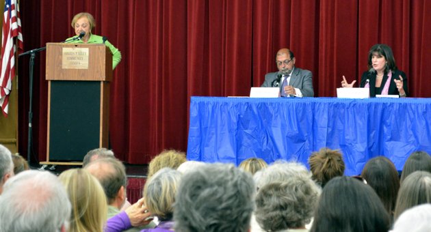 <p>Moderator Irene Stone, left, of the League of Women Voters poses questions to Second District supervisor candidates Roger Aceves and Janet Wolf during Wednesday night&#8217;s forum.</p>