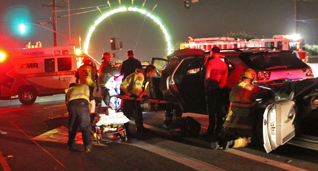 <p>Emergency personnel tend to a patient who was injured Thursday night in a hit-and-run collision near the Earl Warren Showgrounds in Santa Barbara.</p>