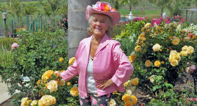 <p>Health and lifestyle crusader Patricia Bragg tends a garden with more than 700 rose bushes.</p>