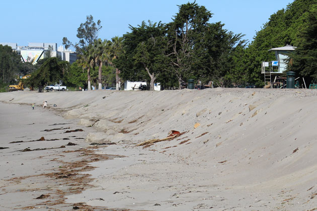 Little remains of a sand berm that was constructed earlier this year at Goleta Beach Park to help protect against large waves and high tides.
