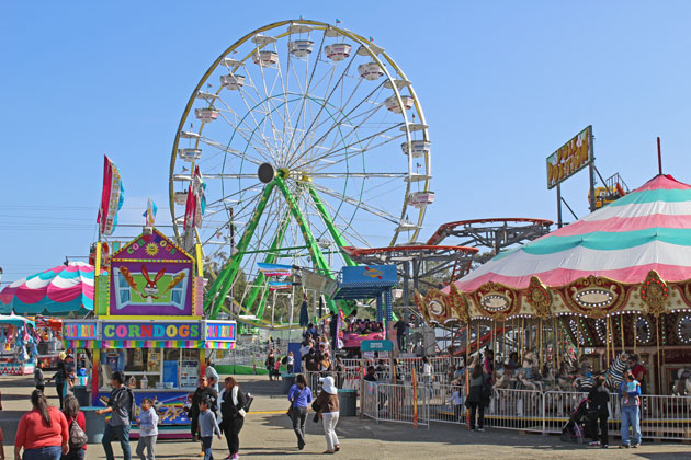 This year's Santa Barbara Fair and Expo feaures a dizzying array of rides, including seemingly every possible type of spinning and swinging attraction, a carousel, and the iconic, nearly 100-foot Ferris wheel.