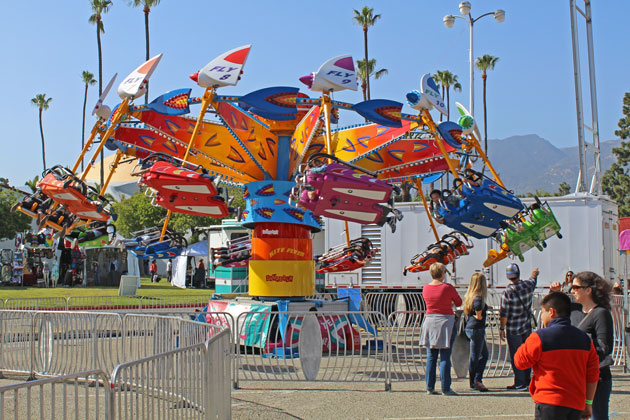 Youngsters enjoy a spin Friday on a carnival ride at the Santa Barbara Fair and Expo.
