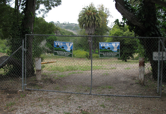 The Veronica Meadows land is currently undeveloped and sits across the road from Elings Park. Both Yes on Y and No on Y signs are scattered near the project site as the June 5 election grows near.