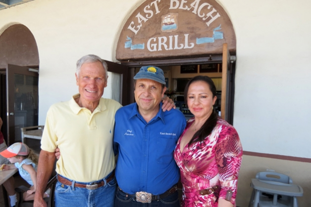 Francisco Aguilera, center, and his wife, Rita, own the East Beach Grill they bought from John Williams eight years ago. The restaurant at theCabrillo Pavilion and Bathhouse at 1118 E. Cabrillo Blvd. has some significant disruption in its future. (Gina Potthoff / Noozhawk photo)