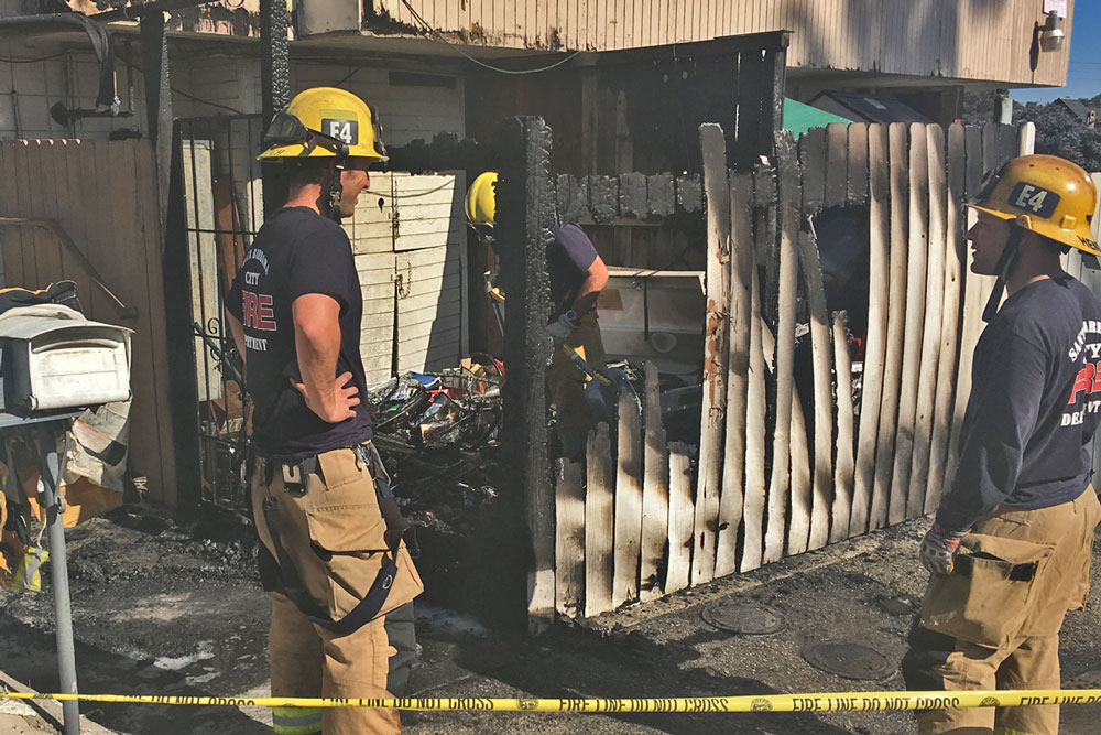 A fire damaged a fenced enclosure at a two-story mixed-use building on Calle Real in Santa Barbara on Tuesday, but firefighters were able to keep the flames from spreading to the adajcent mixed-use building.