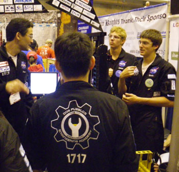 Dos Pueblos Engineering Academy Director Amir Abo-Shaeer, left, confers with Team 1717 members between matches.