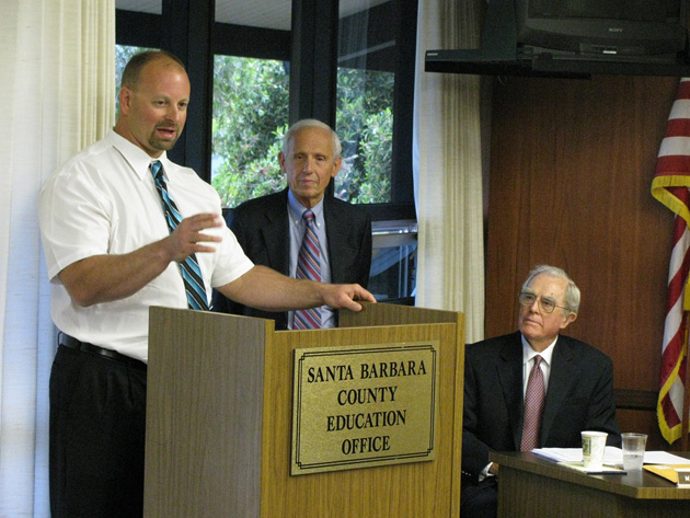 Pioneer Valley High School science teacher Riccardo Magni, left, accompanied by county Superintendent Bill Cirone, center, speaks Thursday after being named Santa Barbara County Teacher of the Year.
