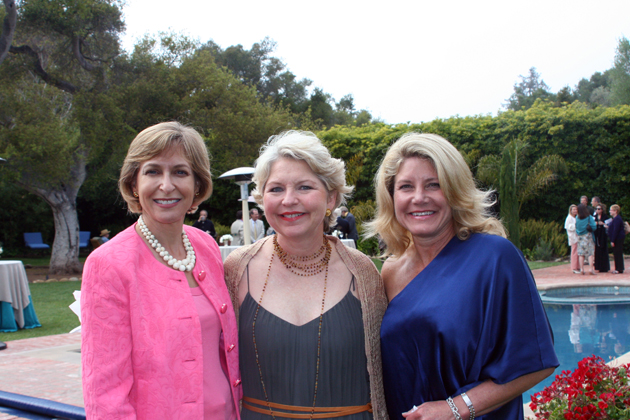 "From left, Springtime Committee members Lauren Katz and Caroline Thompson and co-chairwoman Suzy Cawthon mingle by the pool at the ""Springtime in a Bygone Era"" fundraiser on April 21 benefiting Domestic Violence Solutions of Santa Barbara County held at the historic George Washington Smith Estate of Deborah and Stuart Fuss."
