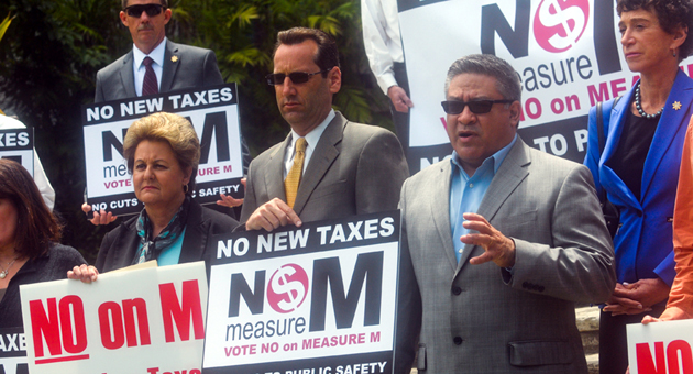 <p>Santa Barbara County Supervisor Salud Carbajal, right, is joined by supervisors Doreen Farr, left, and Steve Lavagnino, among other elected officials, in speaking out Monday against Measure M during a news conference at the Santa Barbara Courthouse. The measure would require maintaining county roads and other facilities at status quo or in better condition.</p>