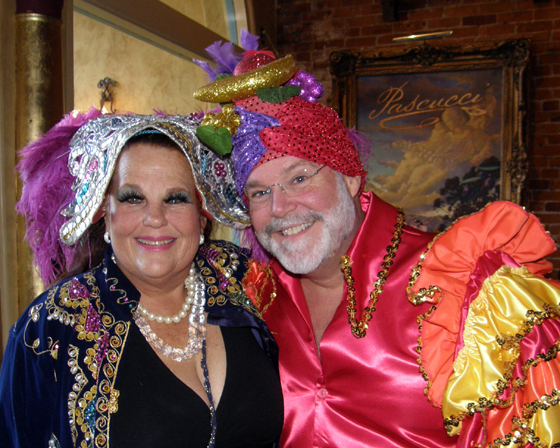 "Santa Barbara Summer Solstice Executive Director Claudia Bratton and volunteer Rob Lathim worked Pascucci Dine Out the year the theme was ""Carnival."""