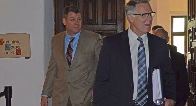 <p>Chief Deputy District Attorney Hilary Dozer, right, and police Sgt. Dave Henderson exit a Santa Barbara courtroom as the trial opened Wednesday over a gang injunction sought by the city.</p>