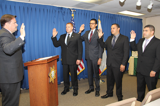 <p>Santa Barbara County Sheriff Bill Brown swears in four custody deputies at a hiring ceremony Monday.</p>