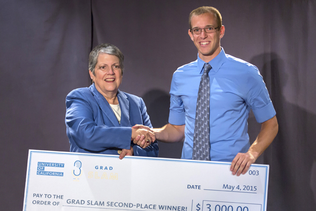 UCSB linguistics Ph.D. student Daniel Hieber receives a $3,000 check from UC President Janet Napolitano for his second-place win in the UC Grad Slam.