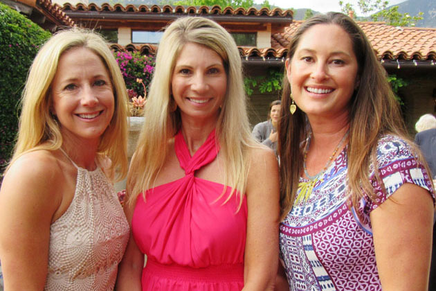 Co-chairwomen Sharon Hughes, left, and Kim Thomas, center, along with committee member Crystal Wyatt share a photo op at Direct Relief Women's sixth annual Mother's Day Celebration held Saturday at the Montecito home of Carrie Ohly-Cusack and Tom Cusack.
