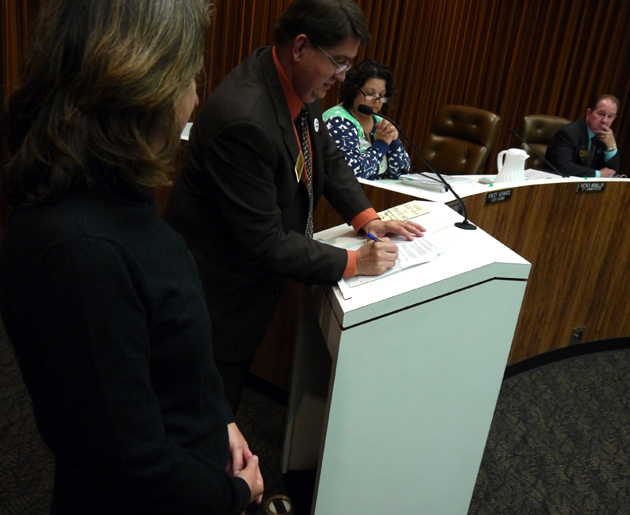 <p>Cecilia Martner, left, president of the Lompoc Theatre Project&#8217;s Board of Directors, watches Lompoc City Administrator Patrick Wiemiller sign the memorandum of understanding between the City of Lompoc and the nonprofit organization during Tuesday&#8217;s City Council meeting. In the background, from left, are City Clerk Stacey Alvarez and Councilman Bob Lingl.</p>