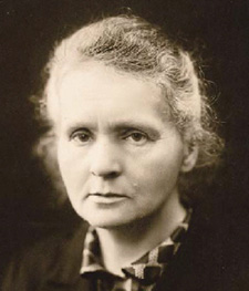 Marie Curie, in 1920 — the eyes a torch for unimagined labyrinths.