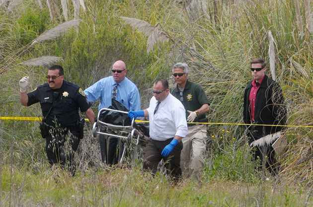 <p>UCSB police and Santa Barbara County Sheriff&#8217;s Department officials remove a decomposed body found on campus last May in a marshy area east of Santa Catalina dormitory.</p>