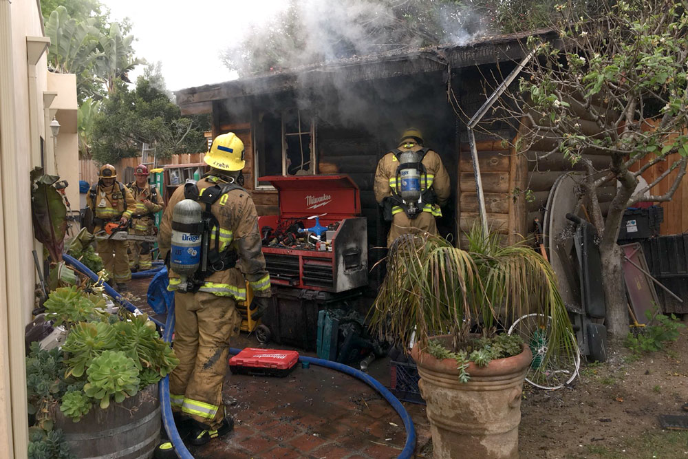 Firefighters at scene of a shed fire near Goleta.