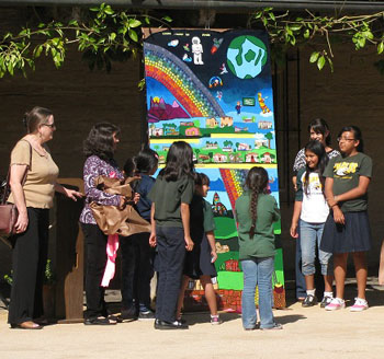 Franklin Elementary School students reveal their mural that will hang in the courtyard of the Santa Barbara School District office.