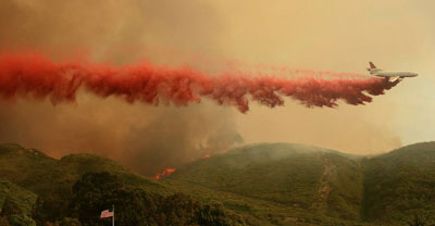A Dc 10 Makes A Drop Of Fire Retardant Earlier This Year