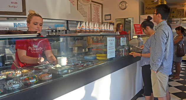 <p>Employees serve ice cream and frozen yogurt to a rush of customers Tuesday night at McConnell&#8217;s on Mission Street in Santa Barbara.</p>