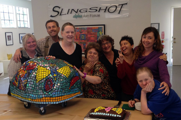 These artists at Slingshot, the Alpha Resource Center's Alpha Art Forum, have completed a mosaic on a boulder fabricated by local mosaic artist Betsy Gallery. Gallery trained the artists to make mosaics based on their own designs. The Alpha Art Forum at 220 W. Canon Perdido St. is open to the public on weekdays (8:30 a.m. to 4:30 p.m.) where their artists' work in many media are for sale. The mosaic boulder was created as a memorial to the mother of Kimberly Olsen, executive director of Alpha Resource Center. It will be installed on the main campus at 4501 Cathedral Oaks Road.