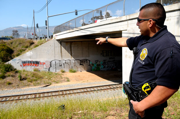 Santa Barbara gang suppression officer Chris Martinez points out a tagging hotspot beneath Las Positas Road.