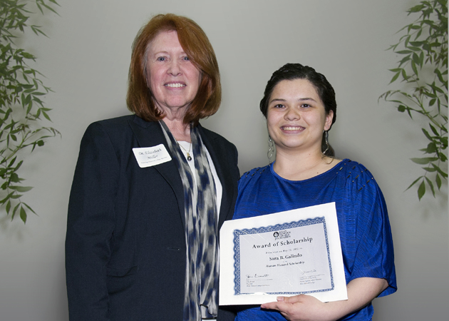 <p>Sara Galindo receives the Marian Hancock Scholarship in 2013 from Allan Hancock College Interim Superintendent/President Elizabeth Miller. The award celebrates the life of the late wife of G. Allan Hancock, for whom the college is named.</p>