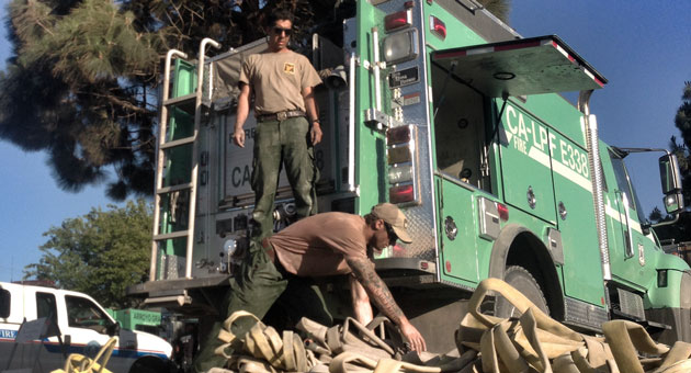 <p>A Los Padres National Forest crew packs up to leave after helping to battle the Miguelito Canyon Fire near Lompoc.</p>