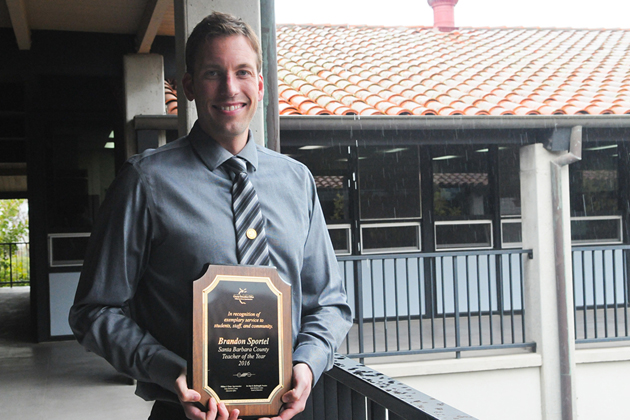 "Brandon Sportel, a special-education teacher at Canalino Elementary School in the Carpinteria Unified School District, with his Santa Barbara County Teacher of the Year award he received Thursday. ""All students have needs, and I've learned that quite well,"" he says."