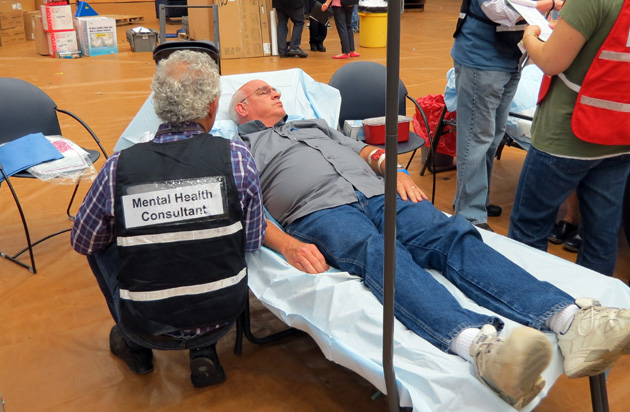 Personnel from several Santa Barbara County emergency agencies evaluate mock patients with faux medical issues during an earthquake disaster drill Wednesday at the UCSB Events Center. (Gina Potthoff / Noozhawk photo)