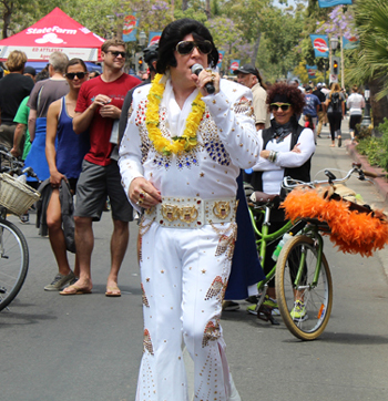An Elvis Presley impersonator was one of several musical acts serenading passersby at the car show.