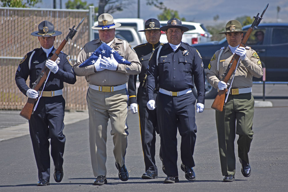 A multi-agency honor team presents the colors during the annual Law Enforcement Memorial at the Santa Maria Police Department on Wednesday.