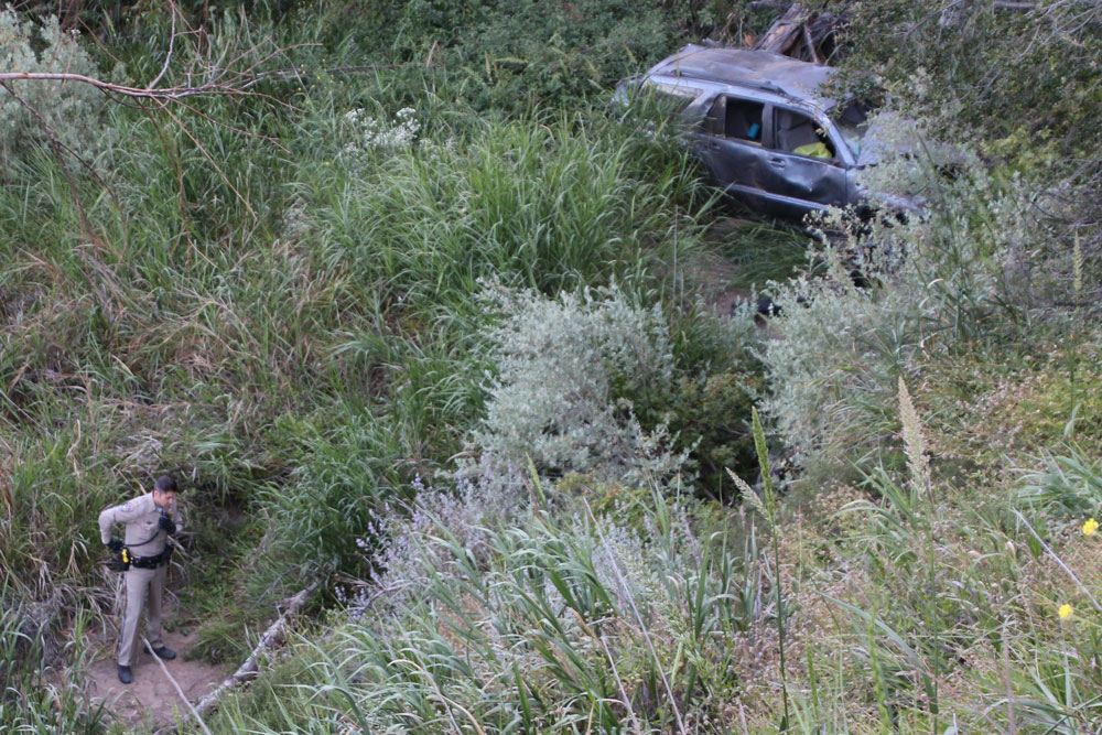 A woman escaped with only minor injuries Friday when her SUV plunged some 100 feet off Highway 154 near Santa Barbara.