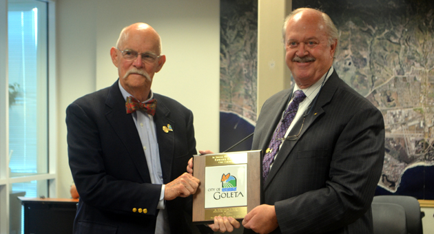 <p>Goleta Mayor Michael Bennett awards Councilman Ed Easton, left, with a City Tile on Tuesday to recognize his years of service with the city. Easton is resigning from the council after moving outside city limits.</p>