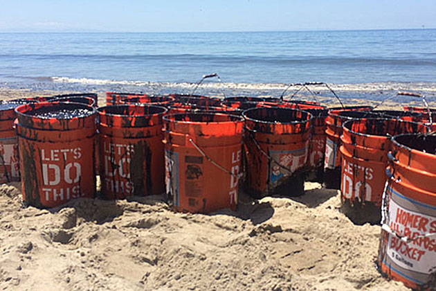 Volunteers filled buckets with oil from the spill at Refugio State Beach on Wednesday, but officials say the well-intentioned efforts are not helping and are asking the public to stay away from the spill area for now.