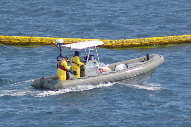 Oil spill response crews deploy booms to collect oil offshore of El Capitan State Beach Thursday afternoon.