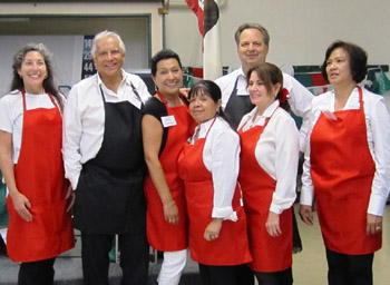 The Dancing Divas and Dudes, from left, Phebe Mansur, David Gonzales, Lola Paredes, Olga Mesa, Linda Gregory, Ed and Jerma Menders served up more than 100 meals — and a ton of fun.