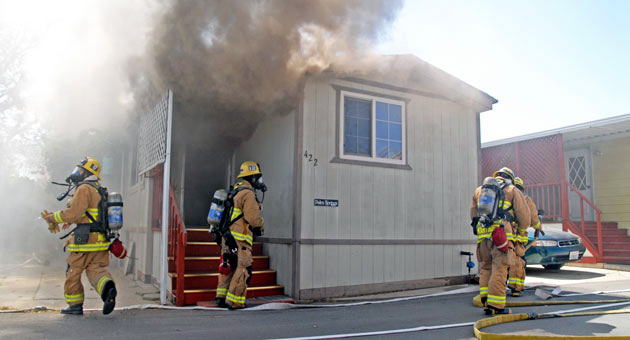 <p>Smoke pours from a mobile home as County Fire crews respond Wednesday to the Rancho Mobile Home Park at 7465 Hollister Ave. in Goleta.</p>